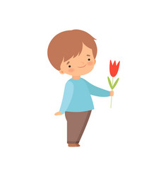 Adorable little boy giving red tulip flower vector