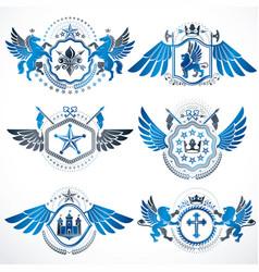 Vintage decorative heraldic emblems composed vector