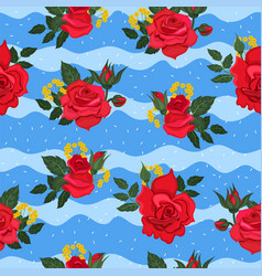 Seamless pattern with red roses on a blue vector