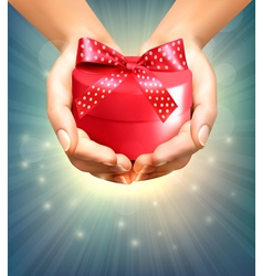 Holiday background with hands holding gift box vector image