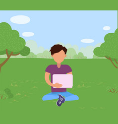 man sitting on grass in park with laptop vector image