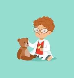 Curly-haired toddler boy examining his patient vector