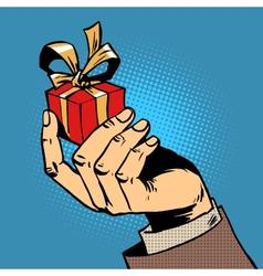 Gift in his hand a small box pop art comics retro vector