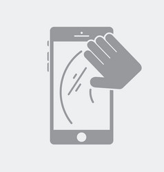 Hand wipes the smartphone screen vector