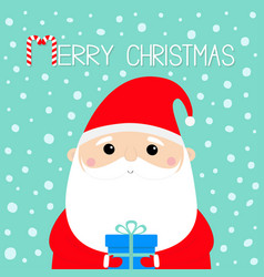Merry christmas santa claus holding gift box vector