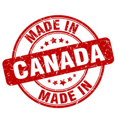 made in canada red grunge round stamp vector image vector image