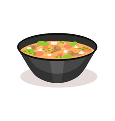 appetizing soup in black ceramic bowl traditional vector image