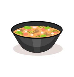 Appetizing soup in black ceramic bowl traditional vector
