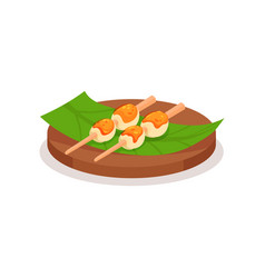 rice balls topped with sweet sauce on green leaf vector image