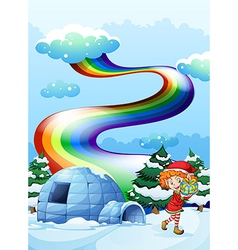 An elf near the igloo with a rainbow in the sky vector image
