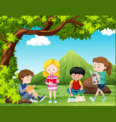 Four kids reading books under the tree vector