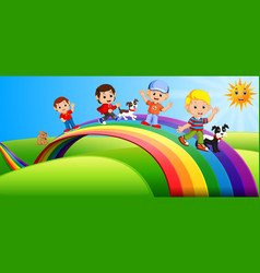 happy kids and dogs standing over the rainbow vector image