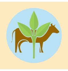 Cow silhouette and green leaves vector