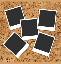 cork board with scattered photo cards vector image