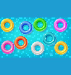 Set of swimming rings floating in the blue water vector
