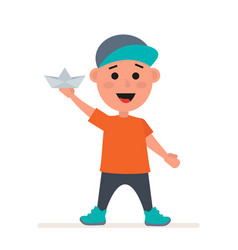 little boy in a cap with a paper boat in his hands vector image