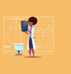female african american doctor examining xray vector image vector image