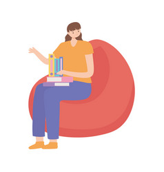 young woman with book sitting on bean chair vector image