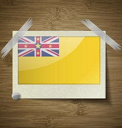 Flags niue at frame on wooden texture vector