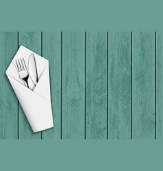 fork and knife in a white napkin vector image