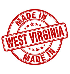 Made in west virginia red grunge round stamp vector
