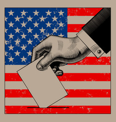 hand putting voting paper on the usa flag vector image