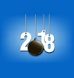 Hockey puck and 2018 hanging on strings vector