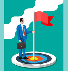businessman in suit standing with flag on target vector image