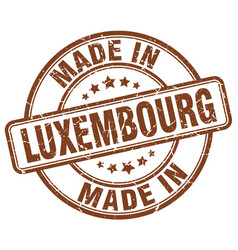 Made in luxembourg brown grunge round stamp vector
