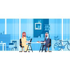 arabic business men sitting at office desk in vector image