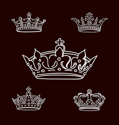 Set white crowns on black background icons vector
