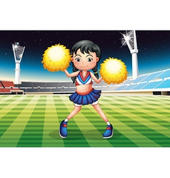 A cheerleader dancing in the stadium with her vector image vector image