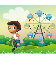 A boy in front of a ferris wheel vector image