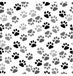 seamless background - pet paw print and bone vector image