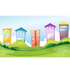 Tall buildings across the hills vector image