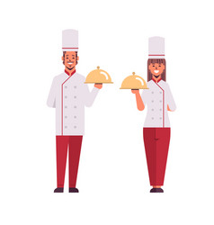 cooks couple professional chefs holding covered vector image