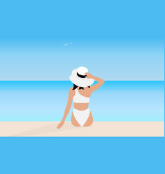 young woman in white bikini and hat sits on beach vector image