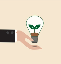 Ecology light bulb on businessman hand vector image