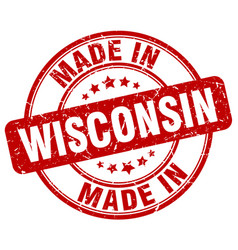 made in wisconsin red grunge round stamp vector image vector image