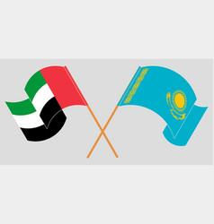 Crossed and waving flags kazakhstan vector