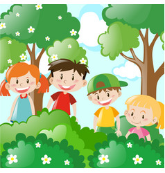 Four kids standing behind the bush vector