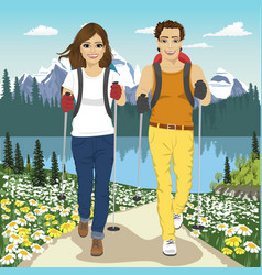 young couple hiking outdoors in summer mountains vector image