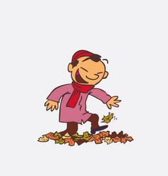 Asian child having fun treading autumn leaves vector