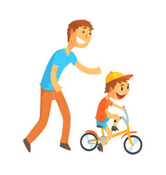father teaching his son to ride a bicycle vector image