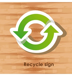 Recycle sign over wooden background vector