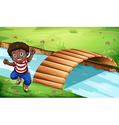 A happy Black kid near the wooden bridge vector