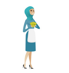 young muslim cleaner holding money vector image vector image