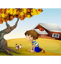 A boy and his puppy under the tree vector