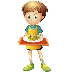 A young boy holding a tray with a plate vector image vector image