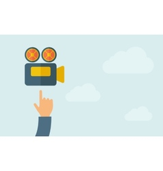 Hand pointing to a video cam icon vector image